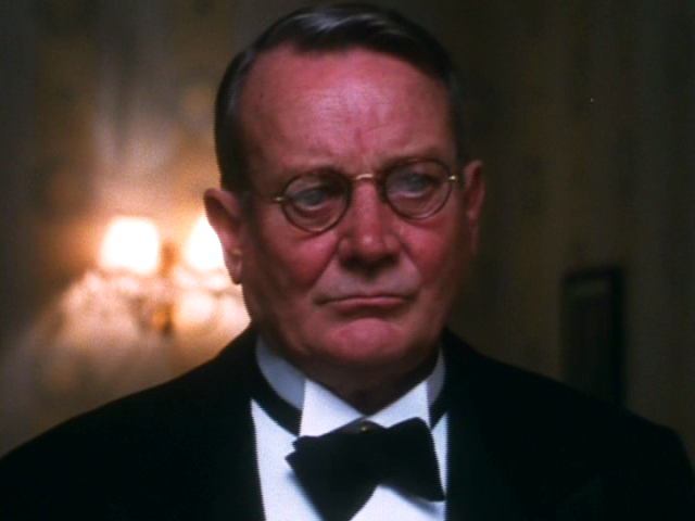 A Murder of Quality Smiley in a tuxedo Denholm Elliott